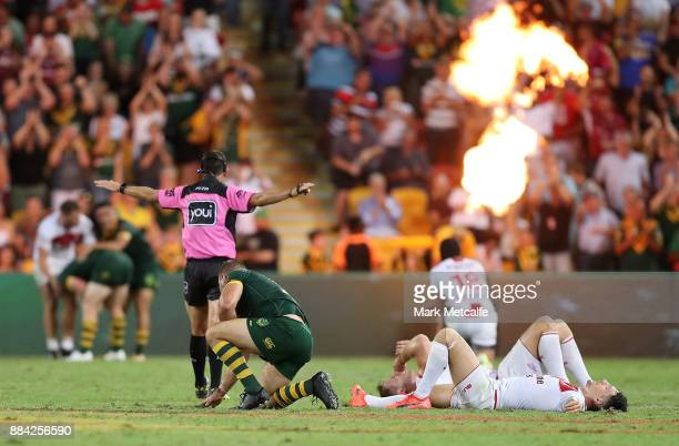 Gareth Widdop of England and team mates lay dejected after defeat in the 2017 Rugby League World Cup Final between the Australian Kangaroos and...