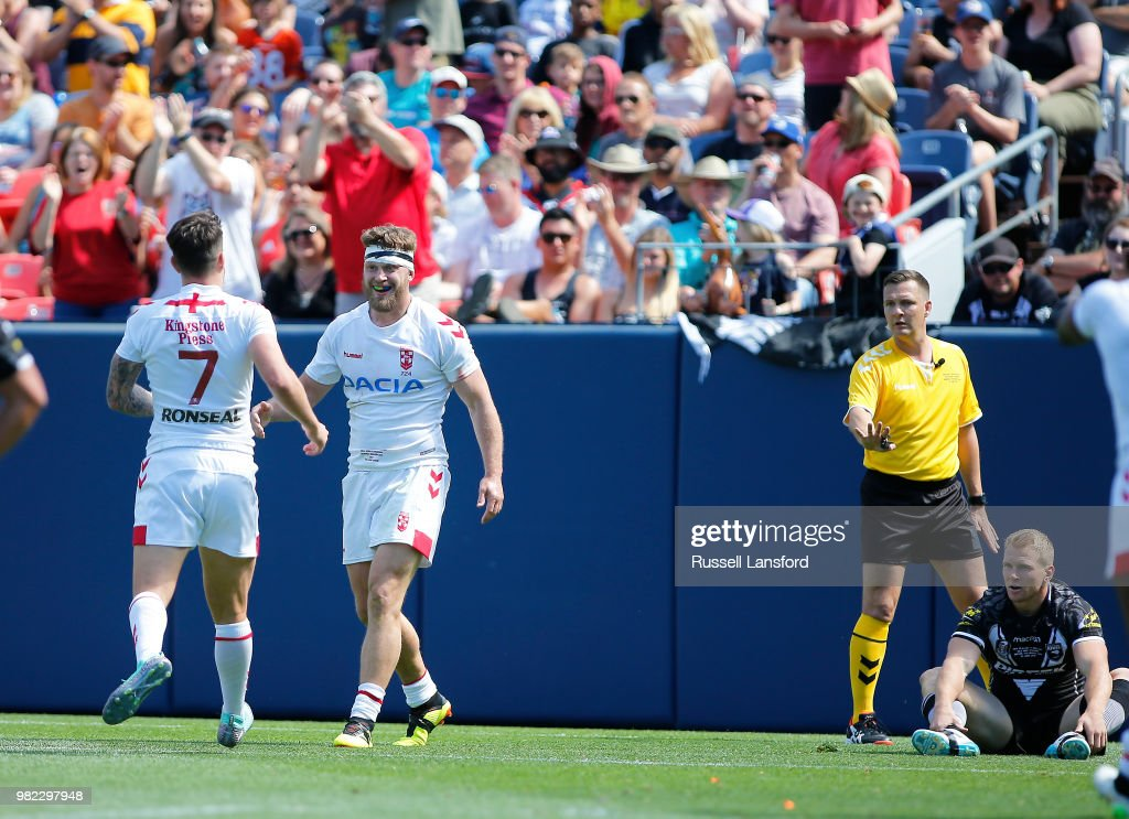 Gareth Widdop of England congratulates Elliot Whitehead following a try during the second half of a Rugby League Test Match between England and the New Zealand Kiwis at Sports Authority Field at Mile High on June 23, 2018 in Denver, Colorado.