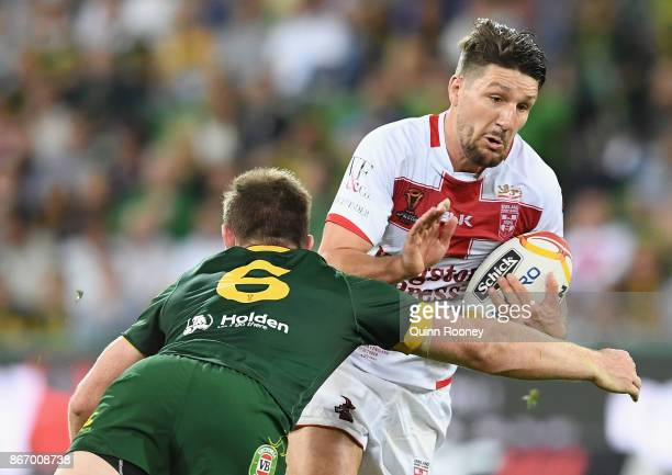 Gareth Widdop of England is tackled during the 2017 Rugby League World Cup match between the Australian Kangaroos and England at AAMI Park on October...
