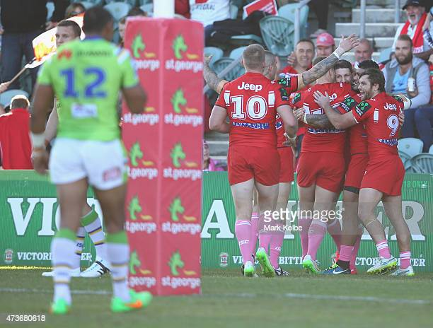 Gareth Widdop of the Dragons celebrates with his team mates after scoring a try during the round 10 NRL match between the St George Illawarra Dragons...