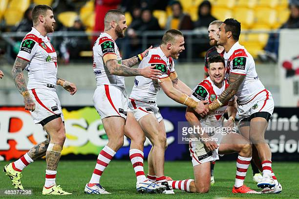Gareth Widdop of the Dragons celebrates with teammates after scoring a try during the round 22 NRL match between the New Zealand Warriors and the St...