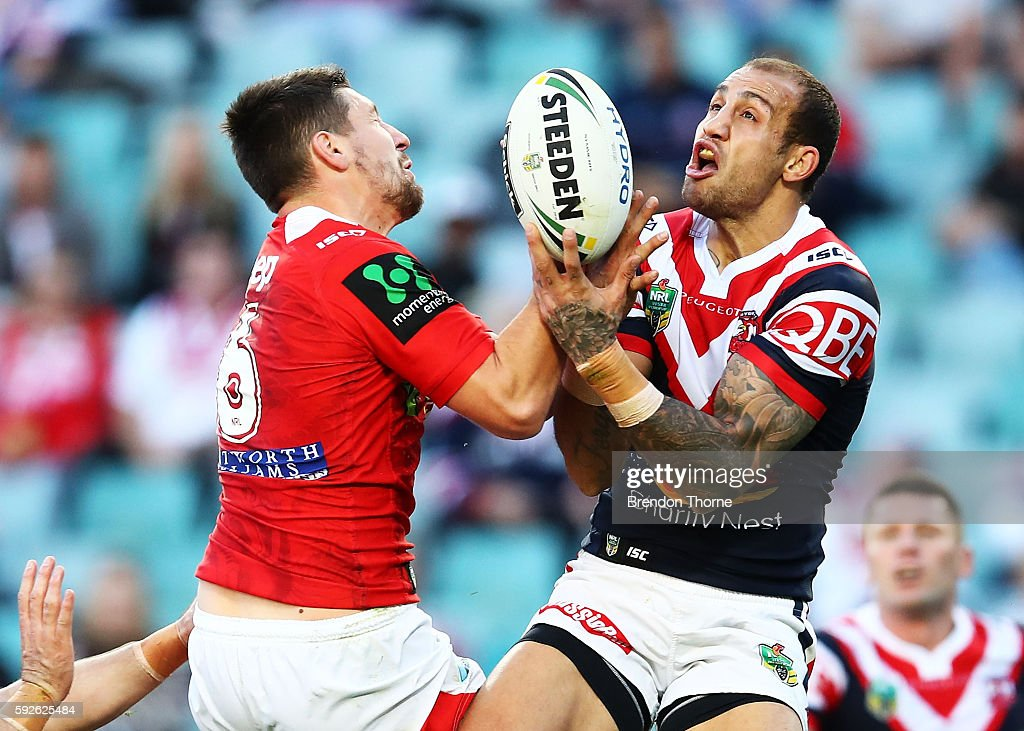 Gareth Widdop of the Dragons competes with Blake Ferguson of the Roosters for a high ball during the round 24 NRL match between the Sydney Roosters and the St George Illawarra Dragons at Allianz Stadium on August 21, 2016 in Sydney, Australia.