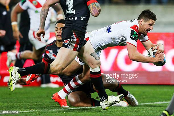 Gareth Widdop of the Dragons dives in to score a try during the round 22 NRL match between the New Zealand Warriors and the St George Illawarra...