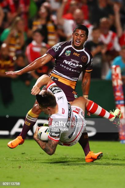 Gareth Widdop of the Dragons is tackled by Anthony Milford of the Broncos during the round one NRL match between the St George Illawarra Dragons and...