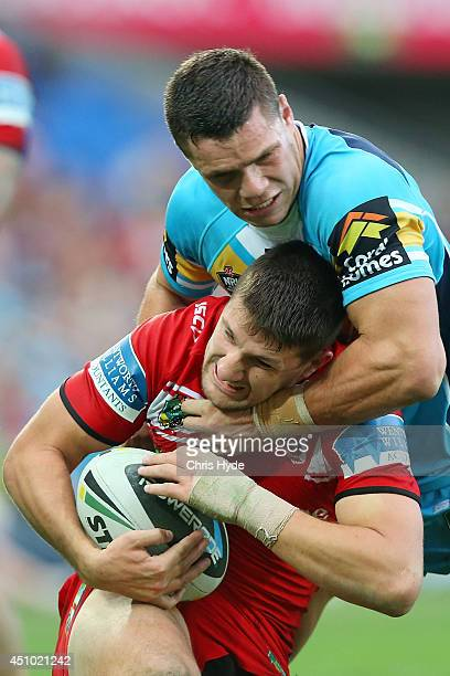 Gareth Widdop of the Dragons is tackled by James Roberts of the Titans during the round 15 NRL match between the Gold Coast Titans and the St George...