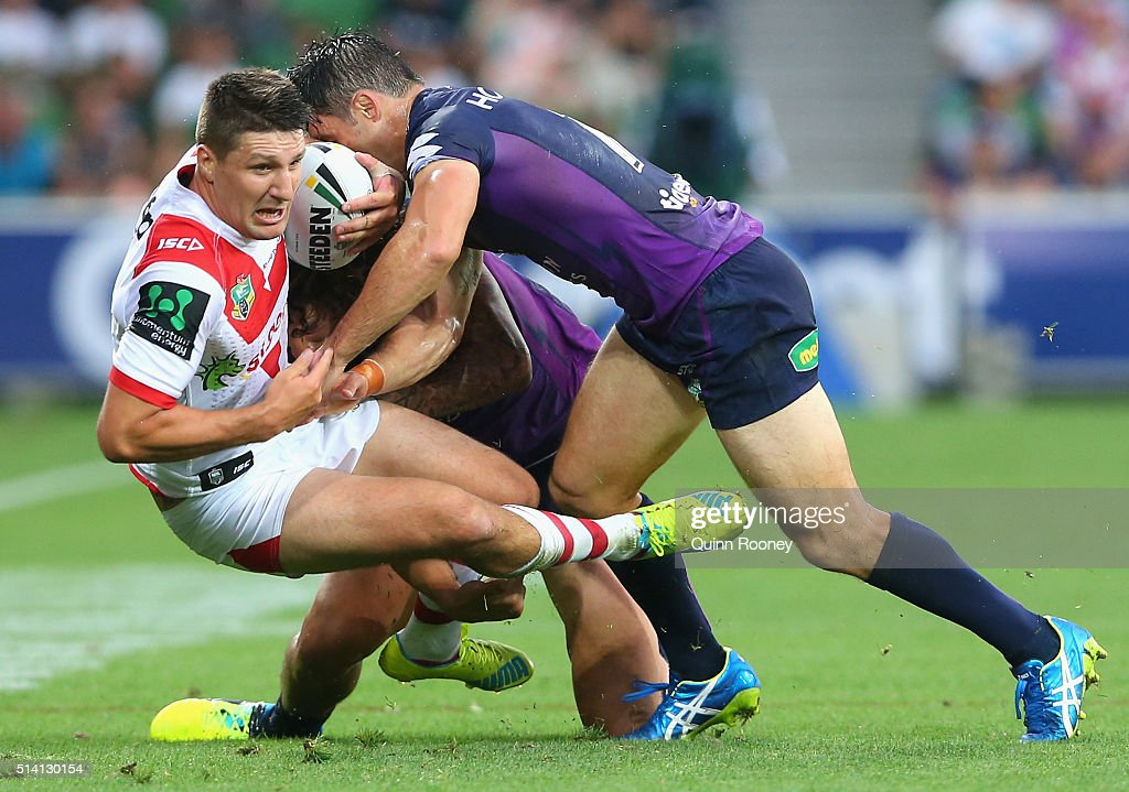Gareth Widdop of the Dragons is tackled by Kevin Proctor and Cooper Cronk of the Storm during the round one NRL match between the Melbourne Storm and the St George Illawarra Dragons at AAMI Park on March 7, 2016 in Melbourne, Australia.