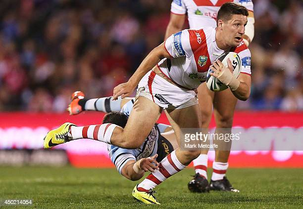 Gareth Widdop of the Dragons is tackled during the round 13 NRL match between the St George Illawarra Dragons and the CronullaSutherland Sharks at...