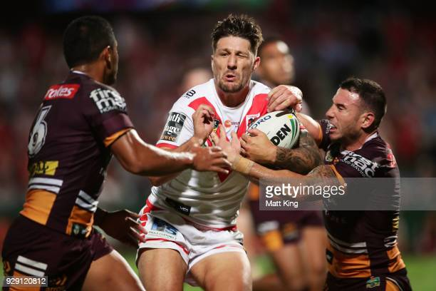 Gareth Widdop of the Dragons is tackled during the round one NRL match between the St George Illawarra Dragons and the Brisbane Broncos at UOW...