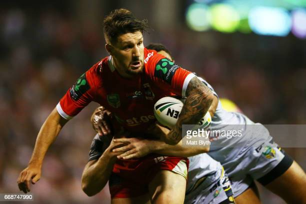 Gareth Widdop of the Dragons is tackled during the round seven NRL match between the St George Illawarra Dragons and the North Queensland Cowboys at...