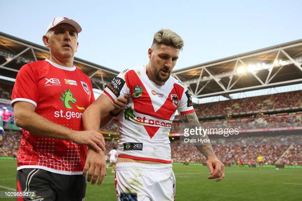 Gareth Widdop of the Dragons leaves the field injured during the NRL Elimination Final match between the Brisbane Broncos and the St George Illawarra...