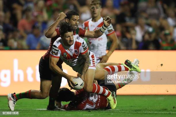 Gareth Widdop of the Dragons looks to pass as he is tackled during the NRL trial match between the South Sydney Rabbitohs and the St George Illawarra...