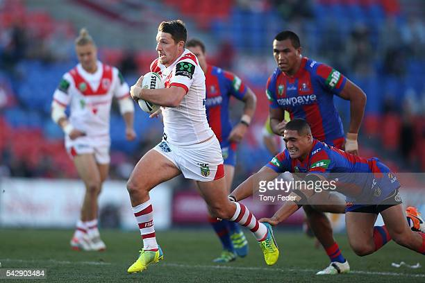 Gareth Widdop of the Dragons runs the ball during the round 16 NRL match between the Newcastle Knights and the St George Illawarra Dragons at Hunter...