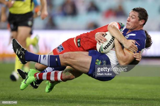 Gareth Widdop of the Dragons tackles Josh Jackson of the Bulldogs during the round 14 NRL match between the Canterbury Bulldogs and the St George...