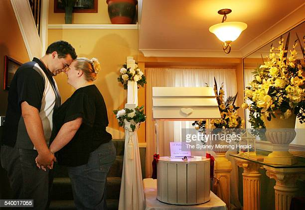 Gareth Williams and his fiancee Rachel Eldridge with the wishing well they will display at their wedding are requesting money instead of gifts 28...