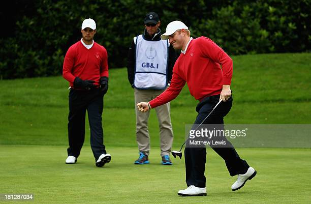 Gareth Wright of GBI celebrates holing a putt on the 16th green to win the morning Foursomes against Mark Sheftic and Chip Sullivan of the USA during...