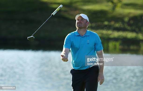 Gareth Wright of the Great Britain Ireland team reacts to a missed eagle putt on the 18th hole during the Friday Foursomes matches at the 27th PGA...