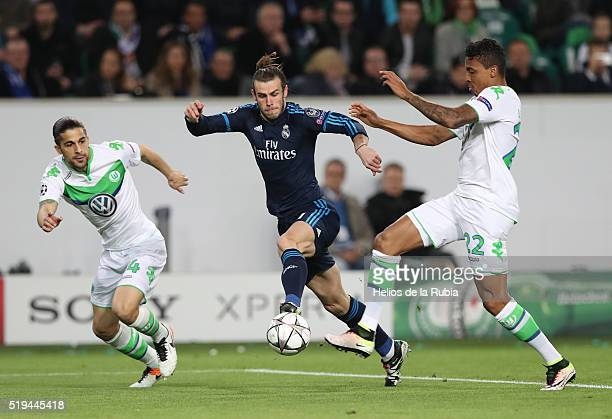 Garetrh Bale of Real Madrid and Luiz Gustavo of Wolfsburg compete for the ball during UEFA Champions League Quarter Final First Leg match between...