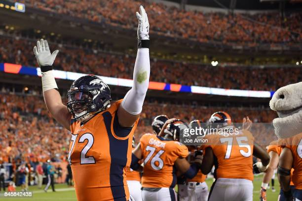 Garett Bolles of the Denver Broncos celebrates a rushing touchdown by Trevor Siemian against the Los Angeles Chargers during the second quarter on...