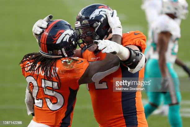 Garett Bolles of the Denver Broncos celebrates the touchdown of Melvin Gordon to take a 2010 lead over the Miami Dolphins during the third quarter at...