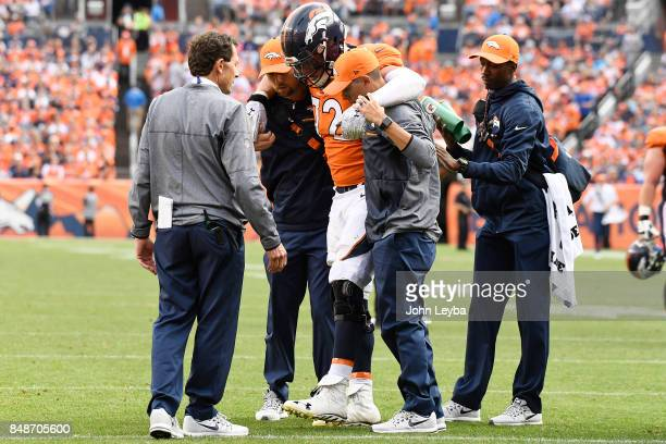 Garett Bolles of the Denver Broncos is helped up after being hurt on a play in the third quarter of the game against the Dallas Cowboys The Denver...