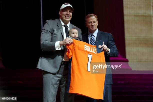 Garett Bolles of Utah and his son Kingston pose with Commissioner of the National Football League Roger Goodell after being picked overall by the...