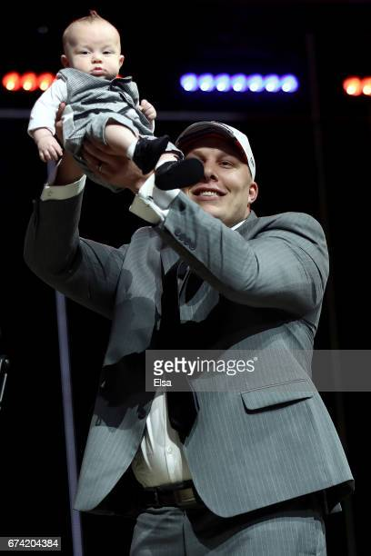 Garett Bolles of Utah reacts with his son Kingston after being picked overall by the Denver Broncosduring the first round of the 2017 NFL Draft at...