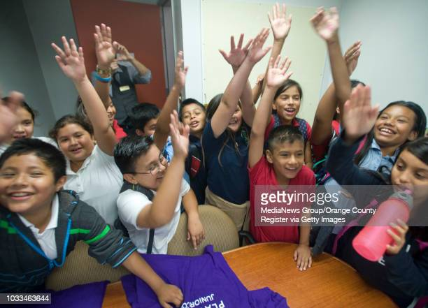 Garfield Elementary School Principal Kasey Mr K Klappenback in back preserves the moment on his cellphone after fourth and fifth grade students find...