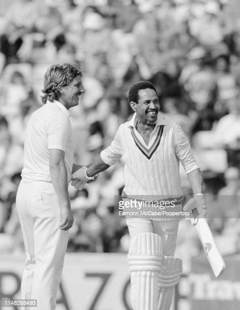 Garfield Sobers representing the Barbados Board of Tourism walks back to the pavilion after being bowled for 12 by Ian Botham representing the World...