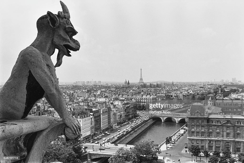 A gargoyle on top of the Notre Dame de Paris cathedral, Paris, France, July 1980.