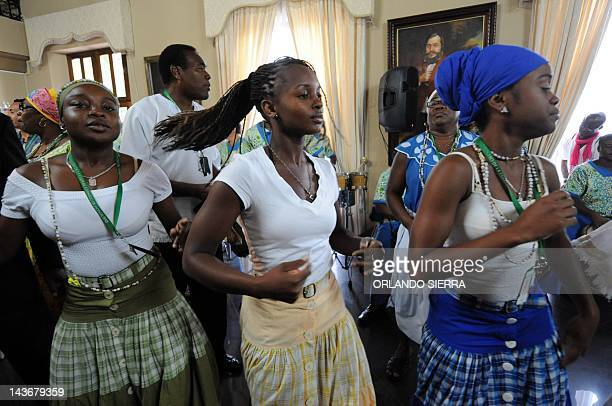 Garifuna dancers perform during the closing ceremony of the Month of African Heritage at the Governmental House in Tegucigalpa on May 2 2012 AFP...