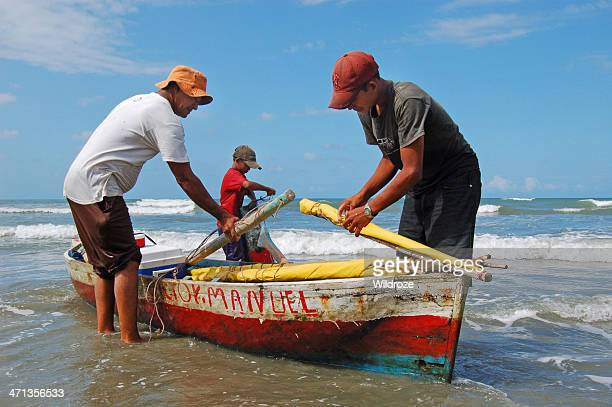 garifuna fisherman and sons bring in catch - honduras stock pictures, royalty-free photos & images