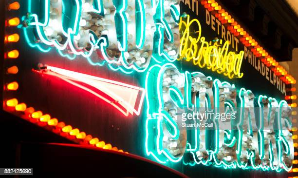 Garish neon signage on steak restaurant