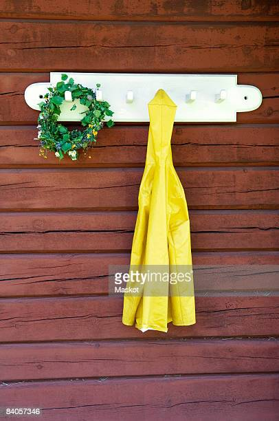 garland and jacket - raincoat stock photos and pictures