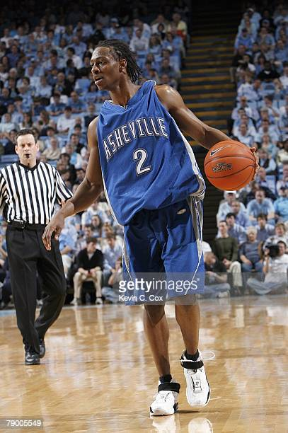 J Garland of the North Carolina Asheville Bulldogs dribbles the ball against of the North Carolina Tar Heels at the Dean E Smith Center on January 9...