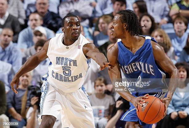 J Garland of the North Carolina Asheville Bulldogs looks to pass against Ty Lawson of the North Carolina Tar Heels at the Dean E Smith Center on...