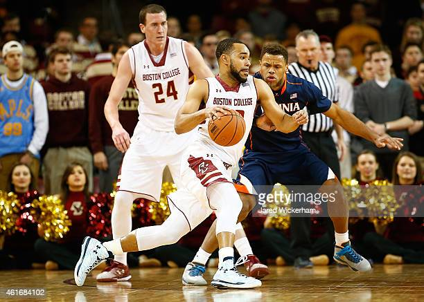 Garland Owens of the Boston College Eagles drives to the basket in front of London Perrantes of the Virginia Cavaliers in the first half during the...