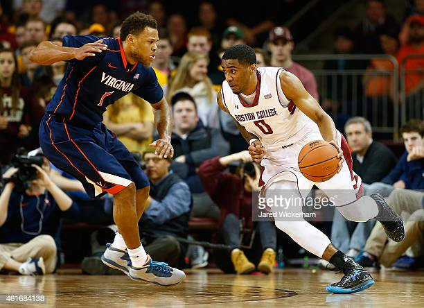 Garland Owens of the Boston College Eagles drives to the basket in front of Justin Anderson of the Virginia Cavaliers in the first half during the...