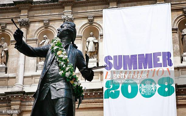 Garlanded statue of Sir Joshua Reynolds greets visitors at Summer Exhibition on June 4, 2008 in London. In it's 240th year, the exhibition displays a...