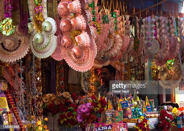 Garlands of the Indian national currency are seen hanging in a shop while a shopkeeper waits for customers on June 20 2012 in Srinagar the summer...