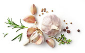 garlic and herbs isolated on white