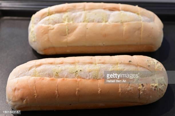 garlic bread on baking tray - rafael ben ari bildbanksfoton och bilder