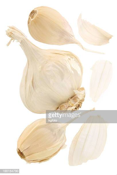 Garlic bulb with split away cloves on a white background