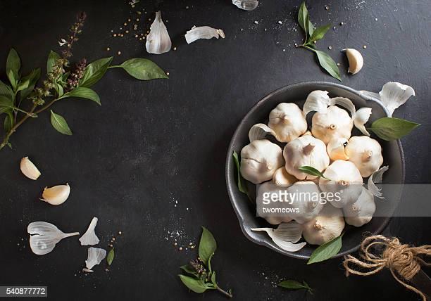 Garlic bulbs bouquet in frying pan.