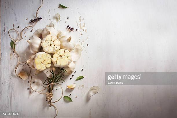 Garlic bulbs bouquet with herbs.