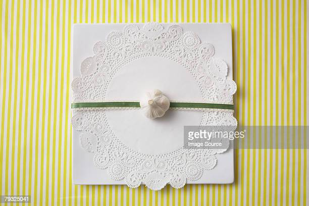 garlic clove on a doilie - doilie stock photos and pictures