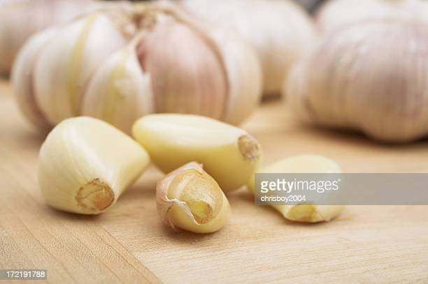 Garlic cloves on a wooden board
