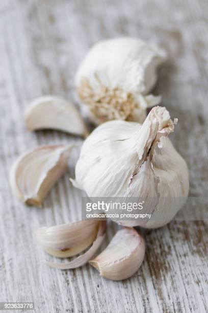 Garlic cloves over a rustic background