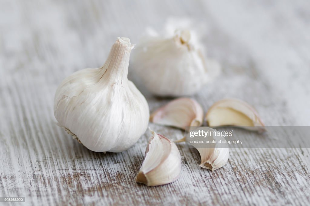 Garlic cloves over a rustic background : ストックフォト