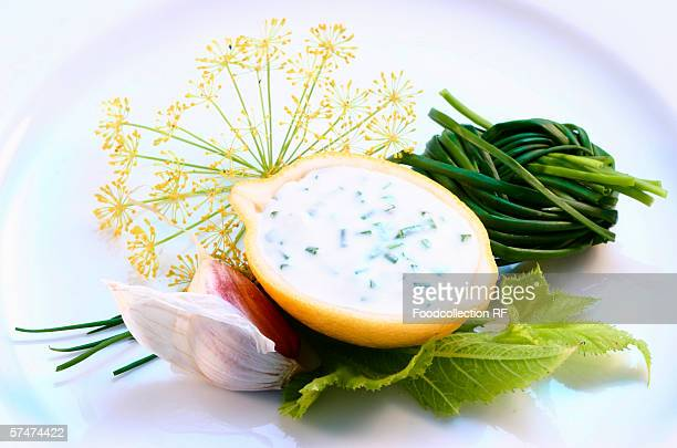 Garlic sauce in hollowed-out lemon; ingredients