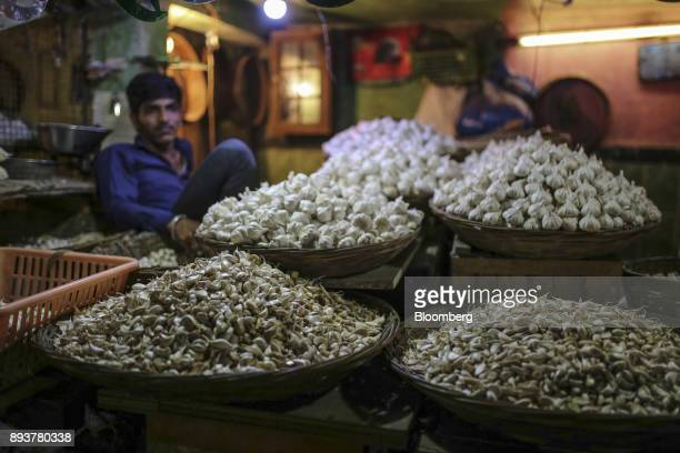 Garlic stand on display for sale at a stall in Mumbai India on Friday Dec 15 2017 India's inflation surged past the central bank's target bolstering...